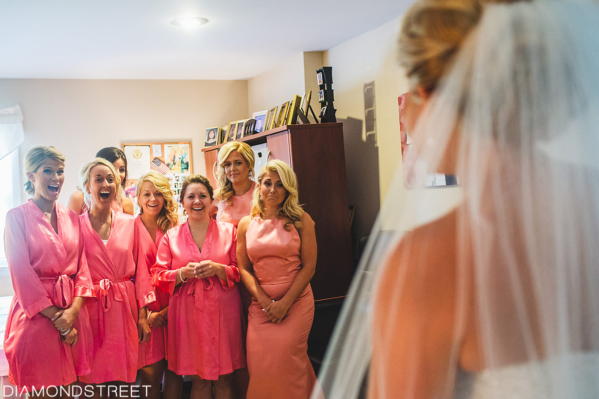 Bridesmaids seeing bride